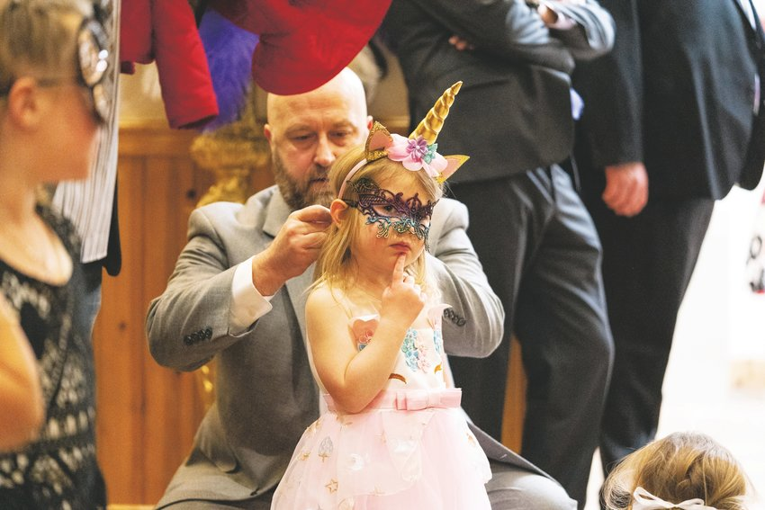The Daddy Daughter Ball had a masquerade theme, encouraging attendees to dress incognito.