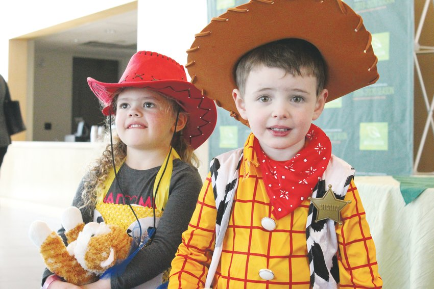 "Tomas and Piper Polce dressed as Woody and Jessie from ""Toy Story"" for a costume contest at the Lone Tree Arts Center Feb. 8. The city is celebrating its 25th anniversary with a series of events throughout 2020."