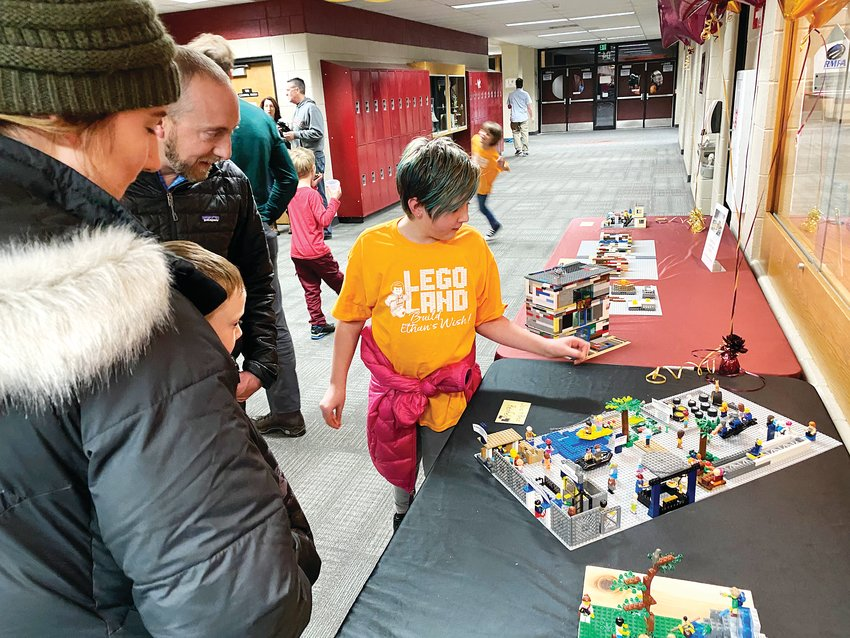 Julie Reinfeld of Legacy Point Elementary School explains her Lego masterpiece for a feeder school competition as part of Ponderosa's Wish Week, which ran from Jan. 31 to Feb. 7.