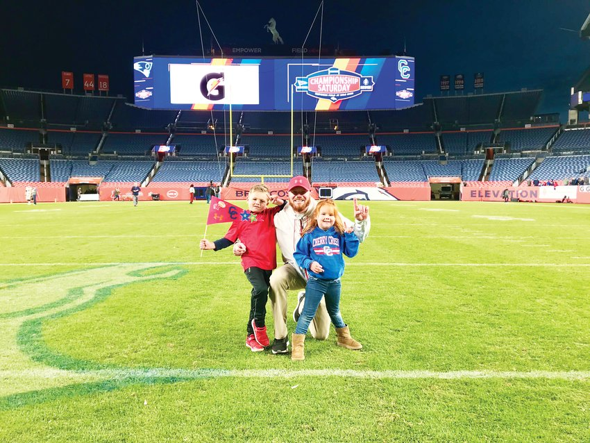 Cherry Creek High School defensive backs coach and special teams coordinator Craig Blaser celebrates with son Braxton and daughter Brooklyn at the 5A football state championship.