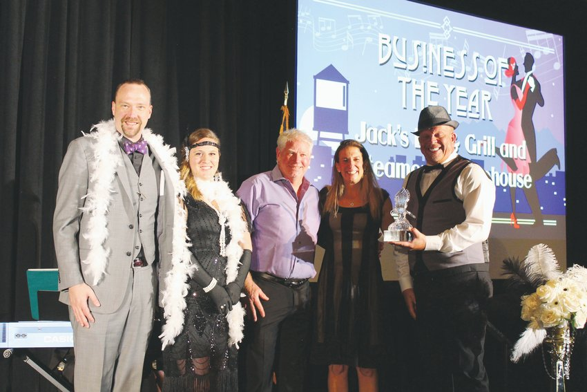The team from Jack's Bar and Grill & Steamers Coffeehouse accepts the Business of the Year award, which the food and coffee establishment received for its commitment to hiring individuals with intellectual disabilities.