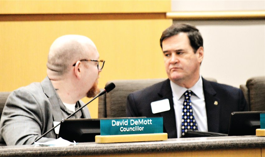 Westminster City Councilors David DeMott and Rich Seymour confer during a public hearing on developer Oread Capital's Uplands development project Feb. 11 at the Westminster City Council. Councilors voted to approve three zoning definition changes for the project which ultimately hopes to build more than 2,300 dwelling units on land surrounding the Pillar of Fire Church at 84th and Lowell Boulevard.