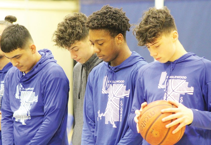 Before Englewood High School tipped off against Fort Lupton High School on Feb. 13, a moment of silence was held for former Englewood Herald reporter Tom Munds, who died Feb. 6. From left are Felipe Gomez, Gunner Johnson, Zack Cave and Hunter Johnson.