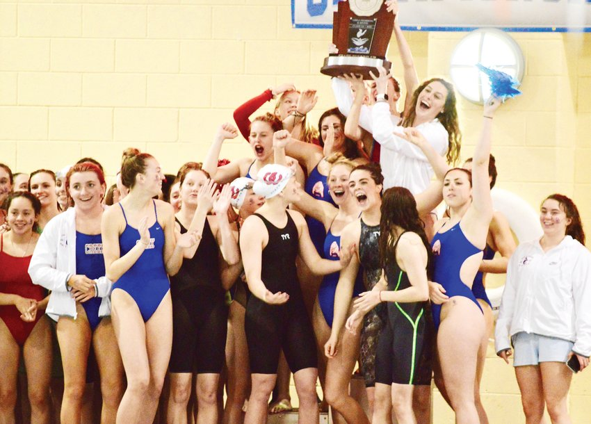 Cherry Creek swimmers celebrate after winning the second-place trophy in the Class 5A state swimming meet held Feb. 13-14 at the VMAC.