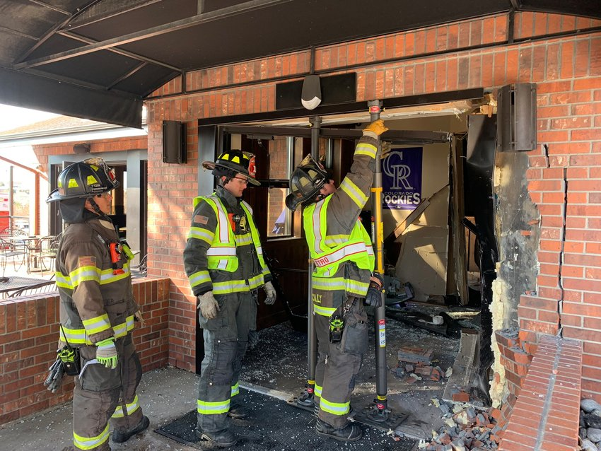 South Metro firefighters examine the scene Feb. 17 after a vehicle crashed into the Boardroom restaurant in Littleton.