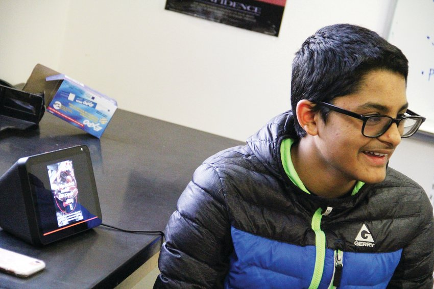 Aditya Krishna, a Creek freshman, talks about navigating a device Feb. 6 at a Generation Tech meeting.