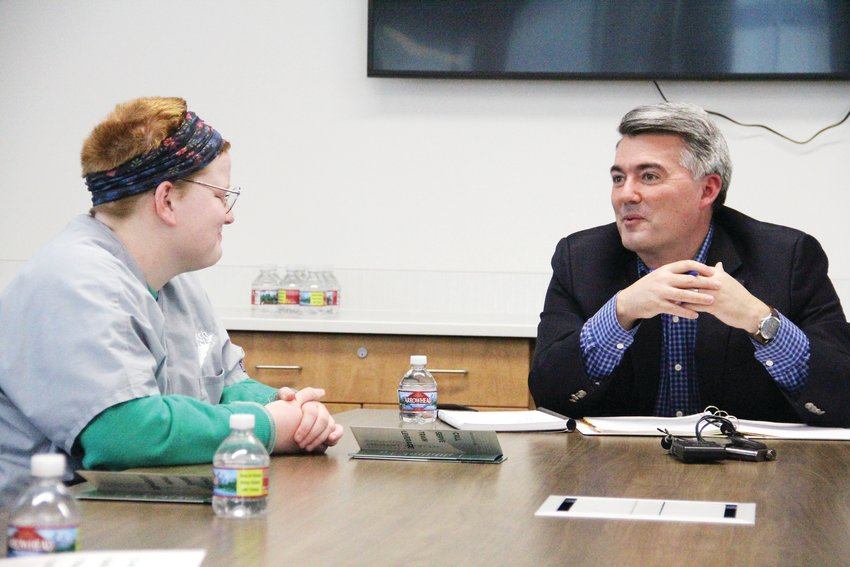 Cherry Creek High School senior Harper Hanson, left, listens as U.S. Sen. Cory Gardner speaks during a Feb. 19 roundtable on mental health at Cherry Creek School District's career-technical education facility.
