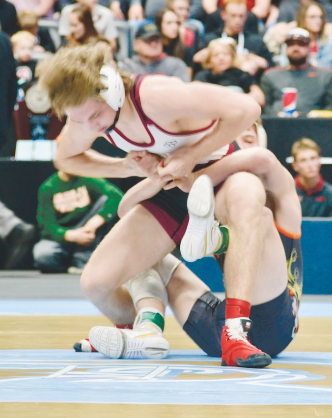 Ponderosa's Jaron Mahler appears to be in control but he  lost a 3-1 decision to Grand Junction's Kieran Thompson in the 132-pound Class 5A title match at the state wrestling tournament on Feb. 22 at the Pepsi Center.