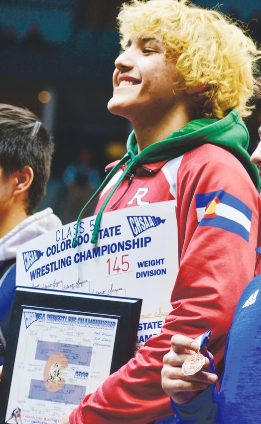 Regis junior Antonio Segura celebrates after winning his second 5A state title on Feb. 22 at the Pepsi Center. Segura defeated Legacy's  Joey Joiner, 10-7, in a rematch of last year's 5A state finale.