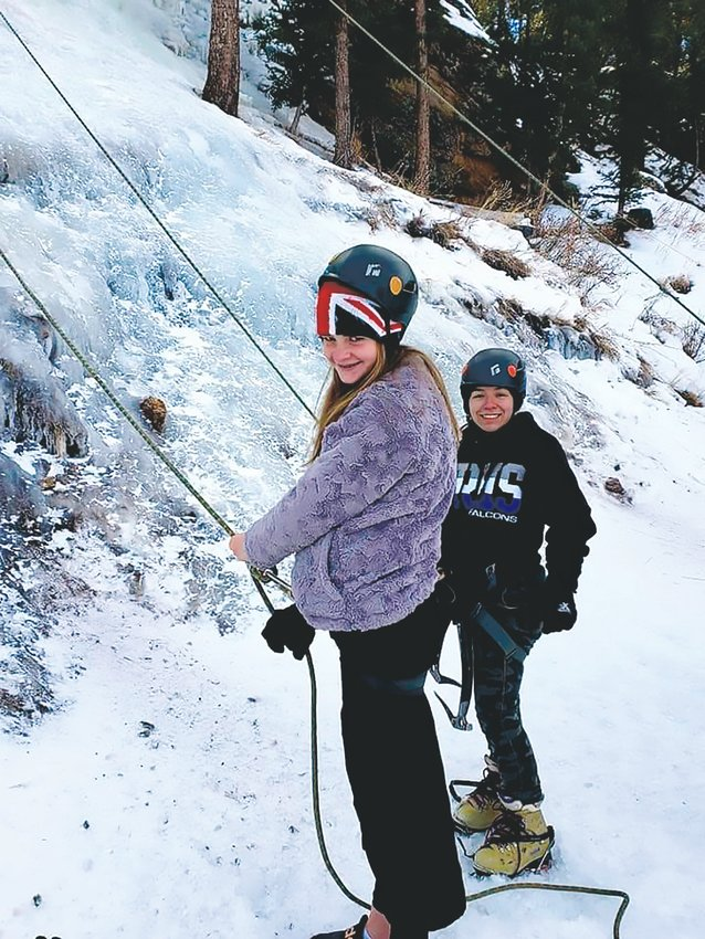From left, Diana Baker, 13, and her sister Tessa Baker, 14, ice climbing with their Girl Scout troop. They have also been backpacking, rappelling, ice fishing and snow shoeing with the organization.