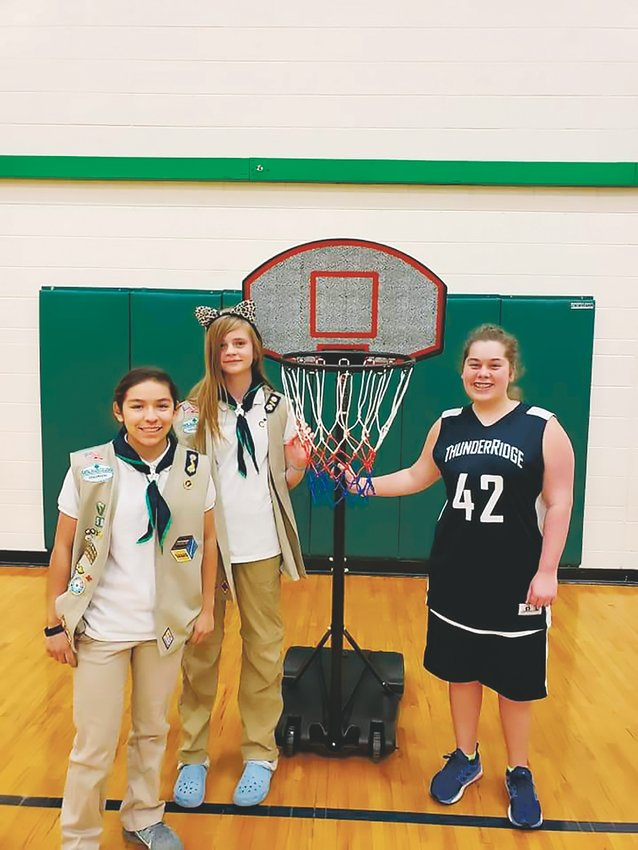 Girl scouts Diana and Tessa Baker completed the qualifications to receive a silver award from the Girl Scouts after they raised money to purchase shortened basketball goals for students with limited mobility last year. In the future, they hope to get gold awards.