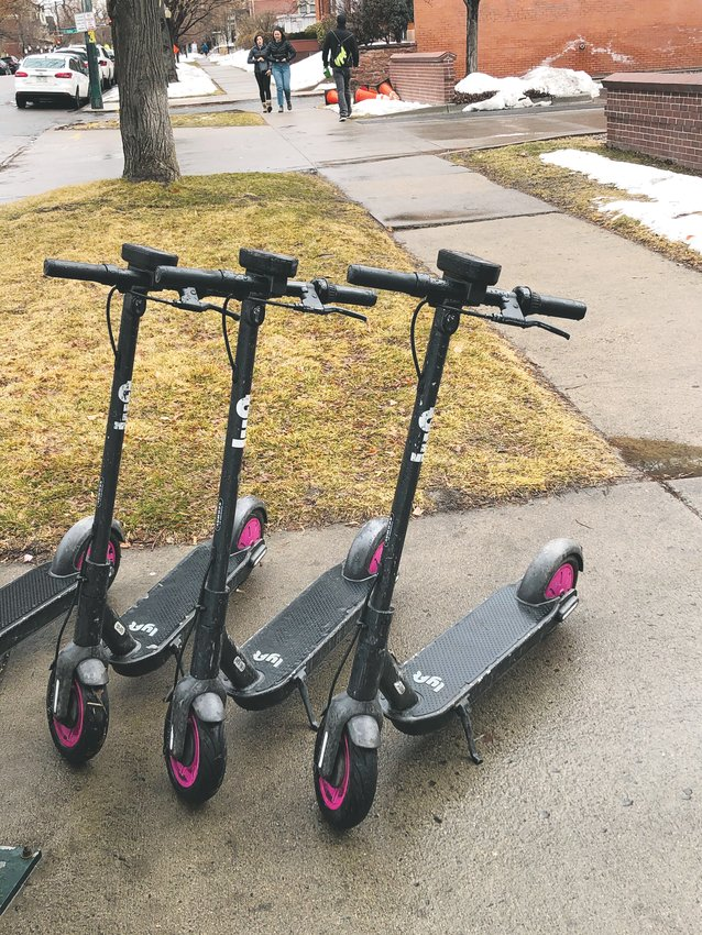 Lyft electronic scooters parked on Clarkson Street in Denver. Lime, a competitor of Lyft, wants to bring 50 electronic scooters to Golden for a pilot program.