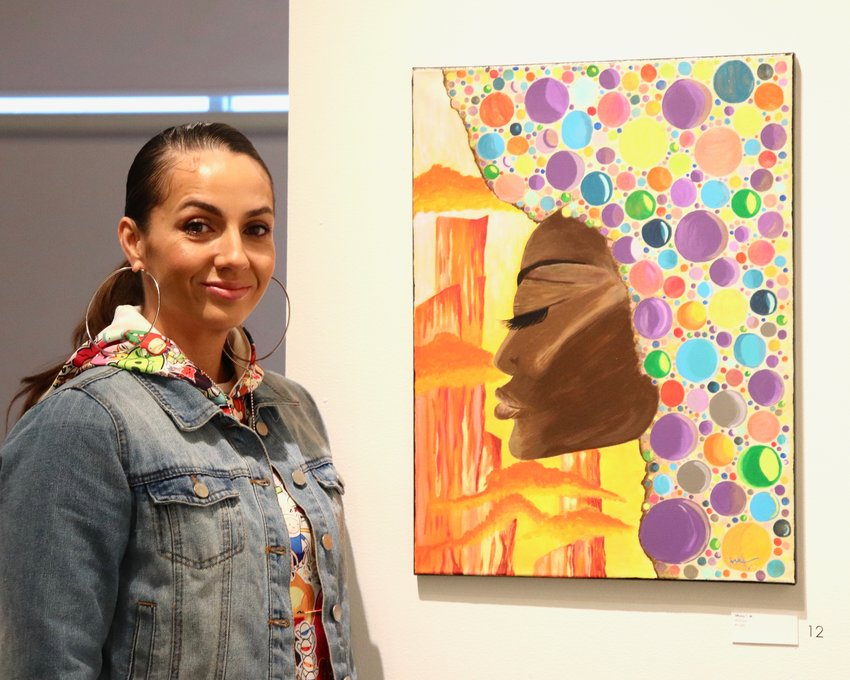 "Artist Tiffany Thomas joined Reach Studio about four months ago after she, her boyfriend and two of her children moved in with her brother in Denver. ""I don't have much space to create where I'm at, so this is an opportunity,"" she said. ""It's a source of happiness."""