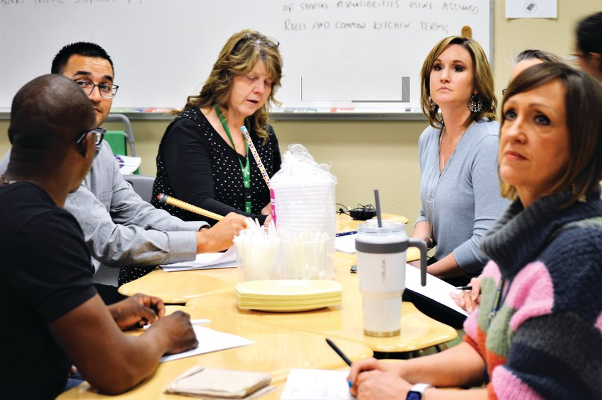 Judges wait for Westminster High School's culinary arts students to serve their preparations Feb. 19. The students' task was to create a winning savory meal made using Girl Scout cookies as a main ingredient.