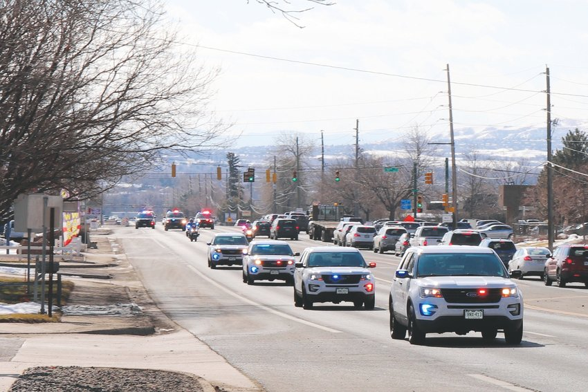 "A procession of first responders travels up Ward Road, toward Red Rocks Church Arvada on Wadsworth, to remember the life of firefighter Dan Moran, who died from a job-related illness. ""Dan fought a courageous two and a half year battle with leukemia; his 18 year career as a firefighter/paramedic with West Metro Fire was unfortunately cut short by this line of duty illness,"" Moran's obituary reads. ""As a husband, father, son, uncle and firefighter, Dan will be missed greatly by all whose lives he impacted."""
