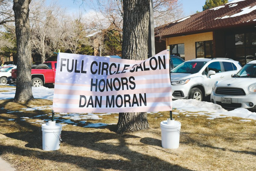 On behalf of business Full Circle Salon & Spa, owned by sister Jennie Trujillo, a family friend set up a sign along the route to honor the family.