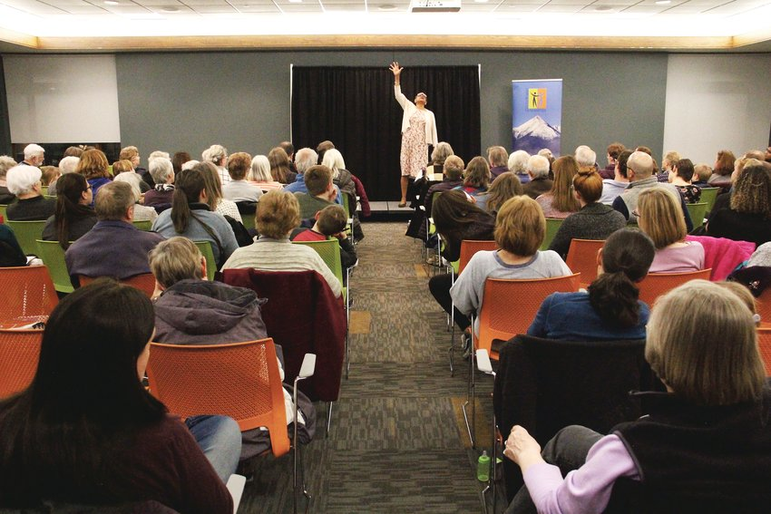 "An audience of more than 120 came to Koelbel Library Feb. 27 for an event called ""History Reimagined: The Rosa Parks Story."" Many of them were small children who asked questions about Parks to Becky Stone, who portrayed her in the performance."