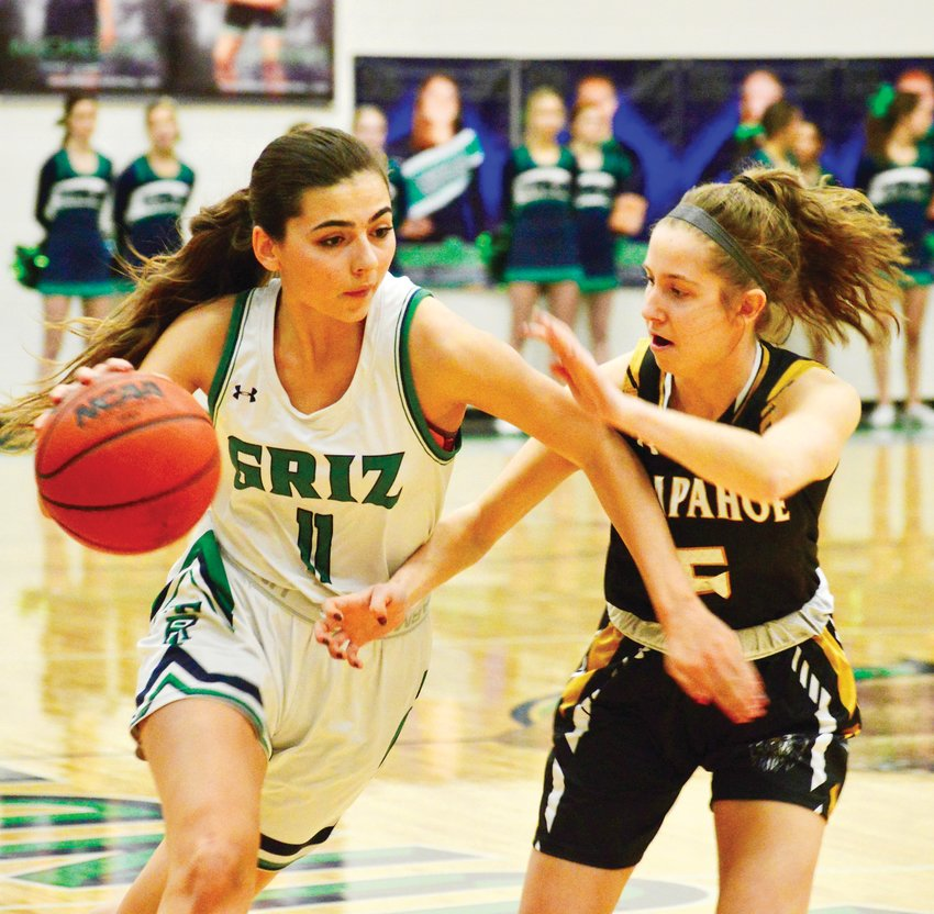 ThunderRidge senior Kristina Keefe, left, is defended by Jayden Staab of Arapahoe during a second-round Class 5A girls state playoff basketball game on Feb. 28 at ThunderRidge. Arapahoe outscored the Grizzlies 15-5 in the fourth quarter and earned a 43-32 victory.