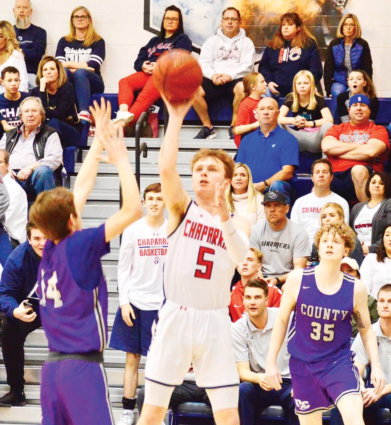Senior Konnor Ruth (5) set a school record with seven 3-point baskets and scored 23 points in Chaparral's 91-64 second-round Class 5A boys basketball win over Douglas County on Feb. 29.