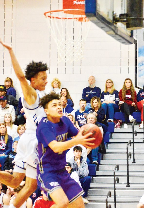 Douglas County's Jaeton Hackley drives in for a layup and he scored 20 points to lead the Huskies, who suffered a 91-64 loss to Chaparral on Feb. 29 in a second-round Class 5A state playoff game.
