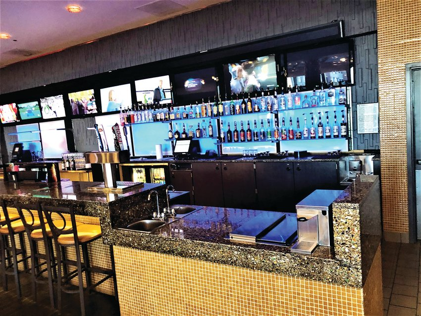 The bar at Regal Southglenn in Centennial. Drinks can also be taken into the theaters.