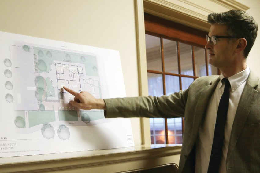 Travis Leiker, president of Capitol Hill United Neighborhoods' board, describes the site plan for a proposed rezone at the Tears-McFarlane mansion, 1290 Williams St.