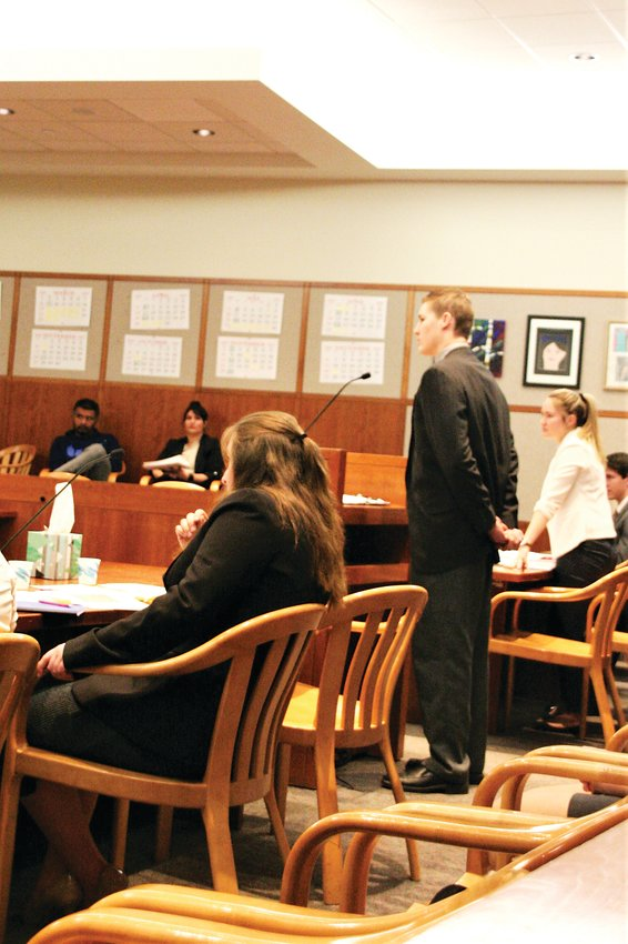 Dakota Ridge High School student Ethan Goode cross-examines a witness in court during the Jeffco Mock Trial tournament on Feb. 29.
