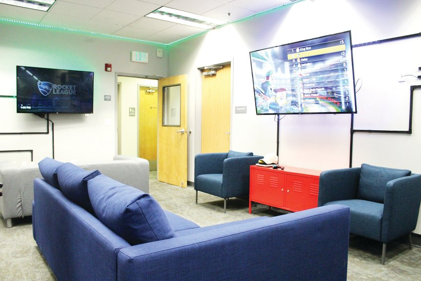 The esports lounge at the Lone Tree Hub was meant to resemble a living room to give a sense of home for gamers. The room has three couches, three TVs, six PCs and six gaming consoles.