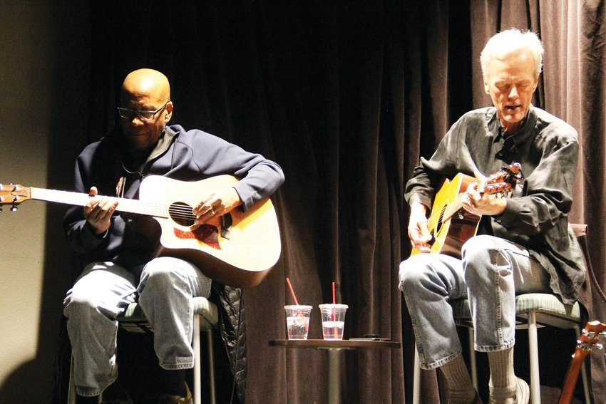 "David East, left, and Dave Schaper perform together March 4 at Koelbel Library's ""Live: Singer and Songwriter Showcase."" The recurring event took place in the library's small, intimate Forum Theater."
