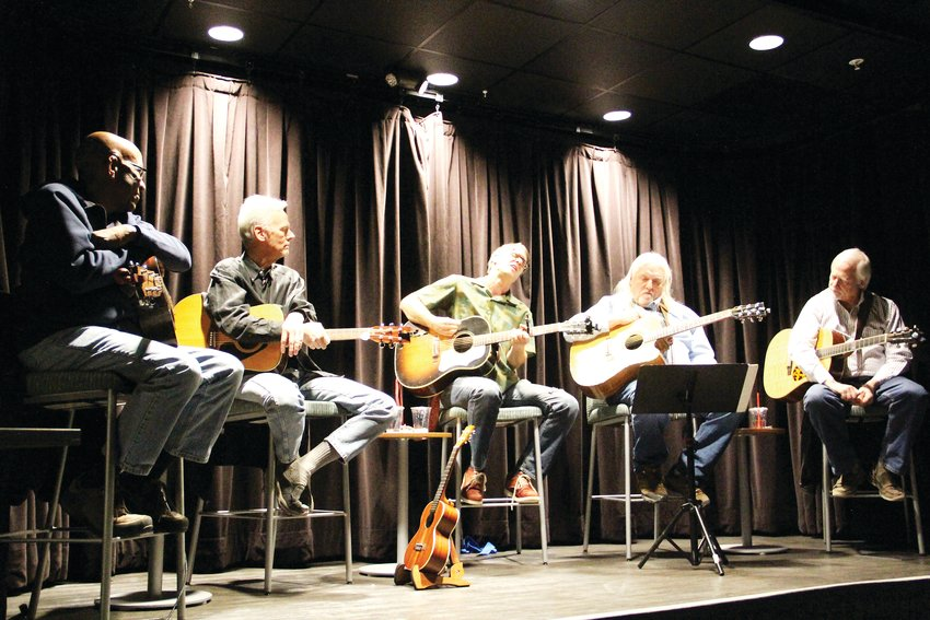 From left, David East, 68; Dave Schaper, 67; Jeremy Facknitz, 42; Doug Kolz, 70; and Mike Overn sit on stage as Facknitz performs.