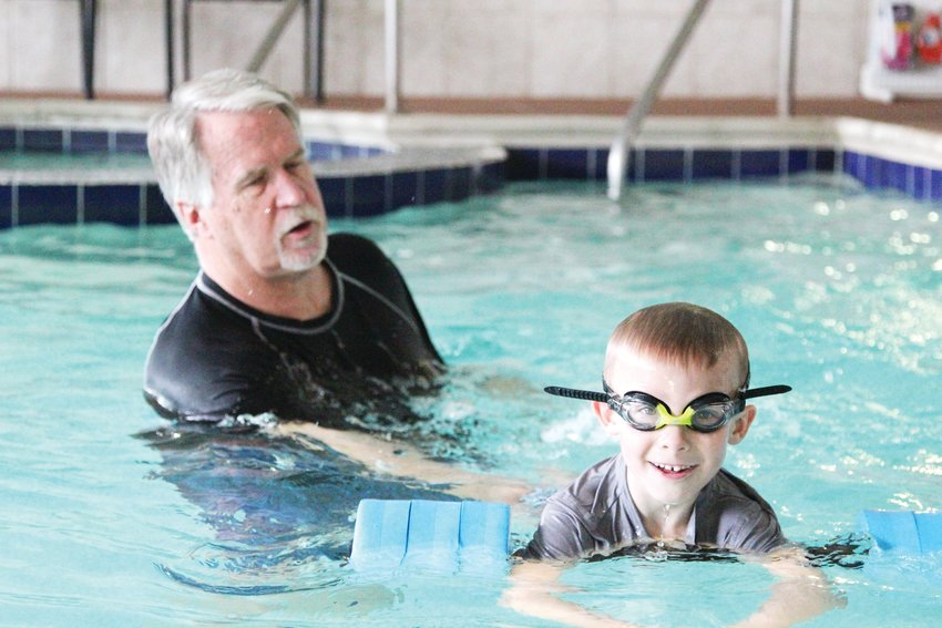 Dylan Williams, 5, swims across the pool during a lesson with Russ Marsh of Smilefish Swim School.