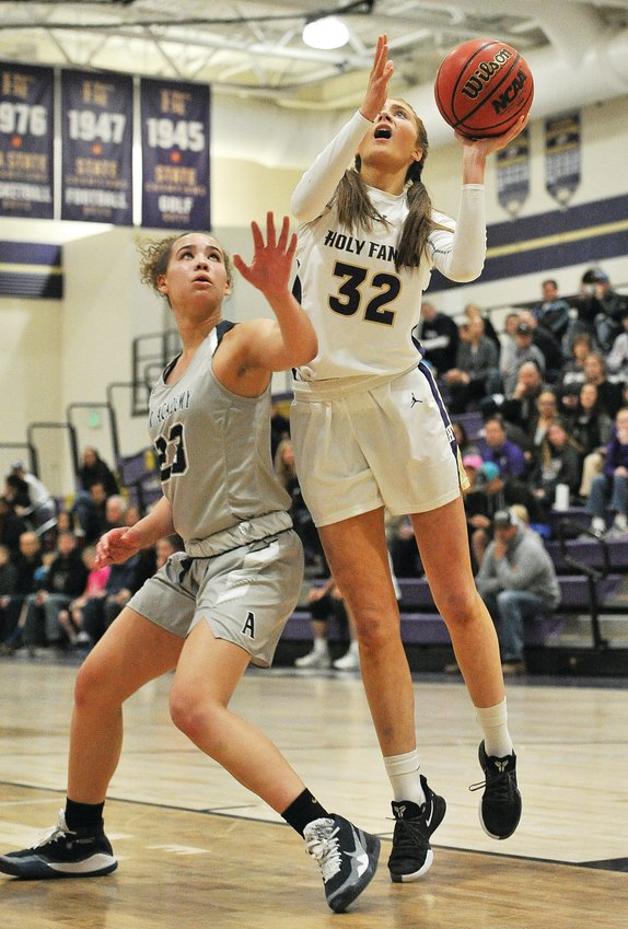 Holy Family's Cecelia Aanerud, right, attempts a shot as Air Academy's Brianna Sealy (23) defends, during the 3rd quarter of a CHSAA Girls 4A playoff game, at Holy Family High School in Broomfield March 3.  The Tigers advanced, beating the Kadets, 42-27.