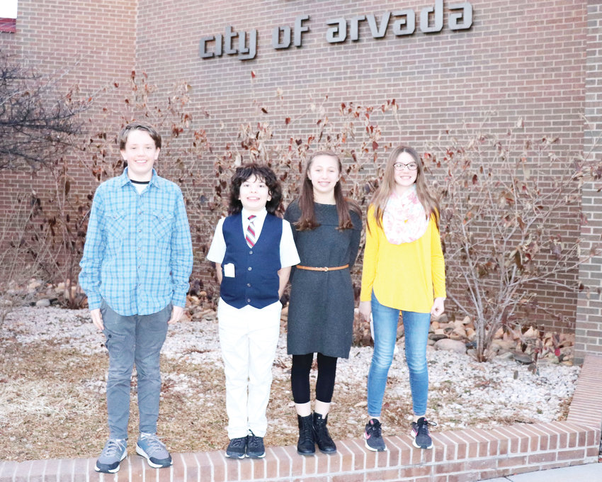 On behalf of their science class, Moore Middle School sixth-graders Drew Charles, left, Walker Munoz, Nikki Cabral and Genevieve Robertson presented to the Arvada City Council March 2, proposing a solution to the pollution in Lake Arbor..