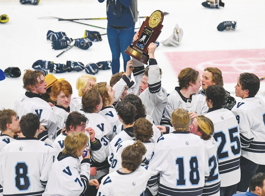 Valor Christian's hockey team celebrates mid-ice as senior captain Mason Hoehn (10) raises the trophy.  It took nearly four hours and five OT periods for the Eagles to score 1-0 on March 10 at the Pepsi Center.