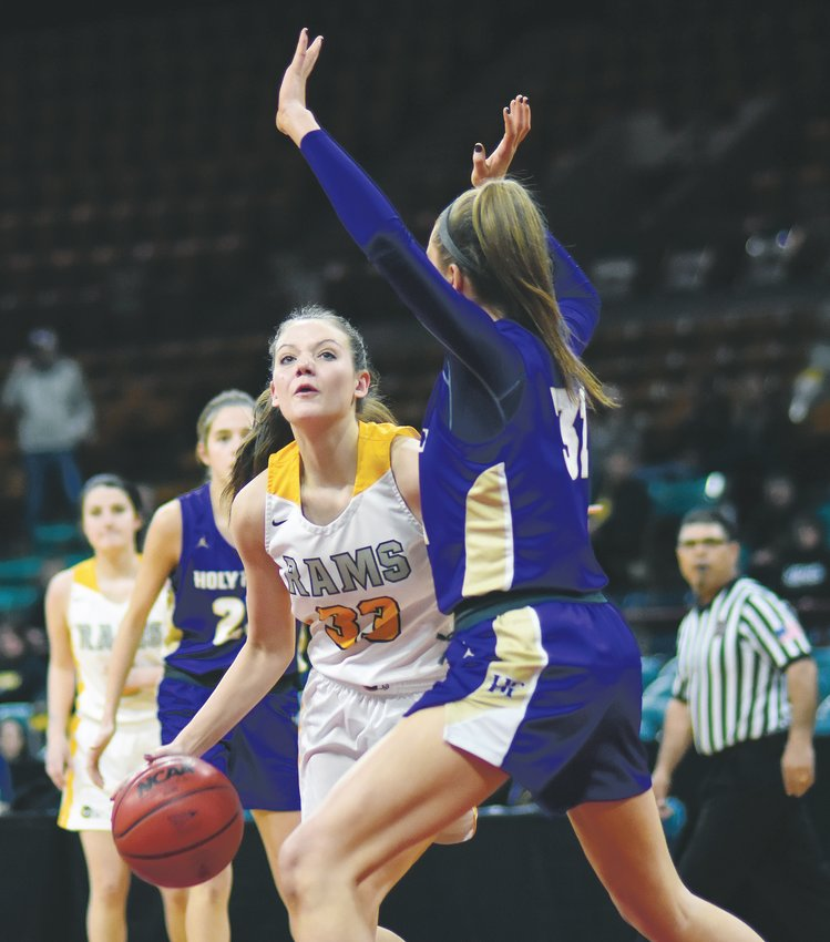 Green Mountain junior Courtney Hank (33) scored a team-high eight points in the Rams' Class 4A girls basketball state semifinal game March 12 at the Denver Coliseum.