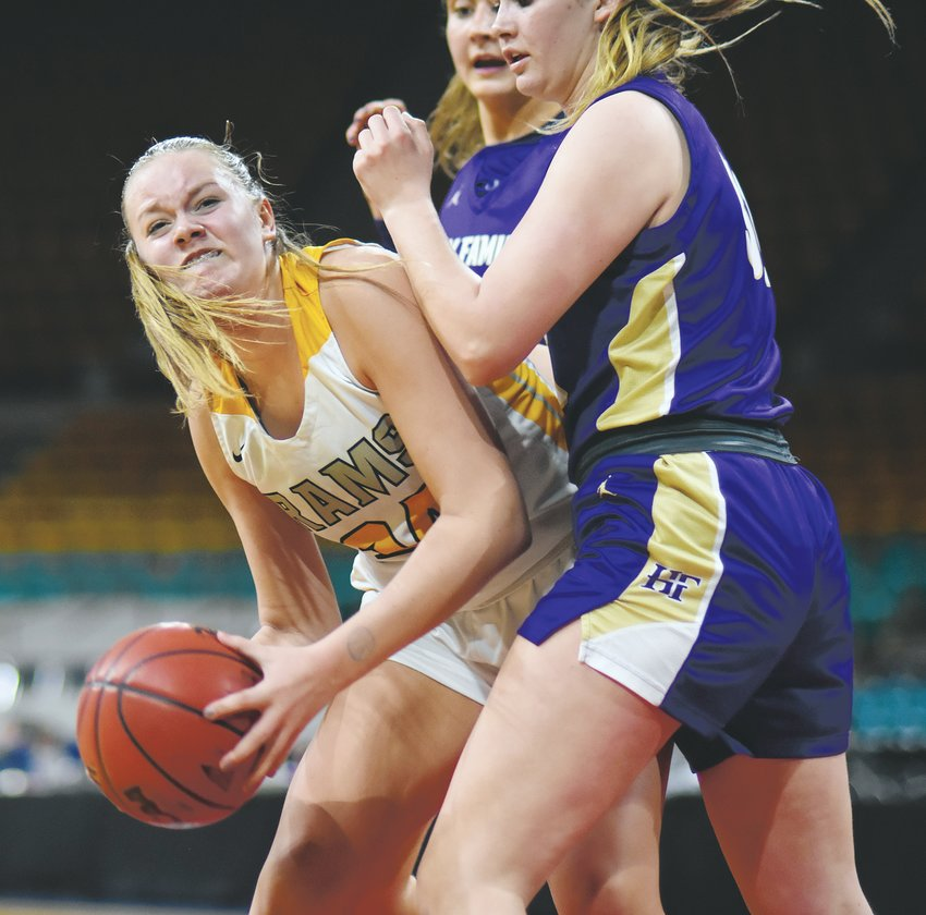 Green Mountain sophomore Avery Oaster (24) fights in the paint during the Class 4A girls basketball state semifinal game Thursday, March 12, at the Denver Coliseum. Oaster had five points and nine rebounds during the Rams' 38-31 loss to Holy Family.