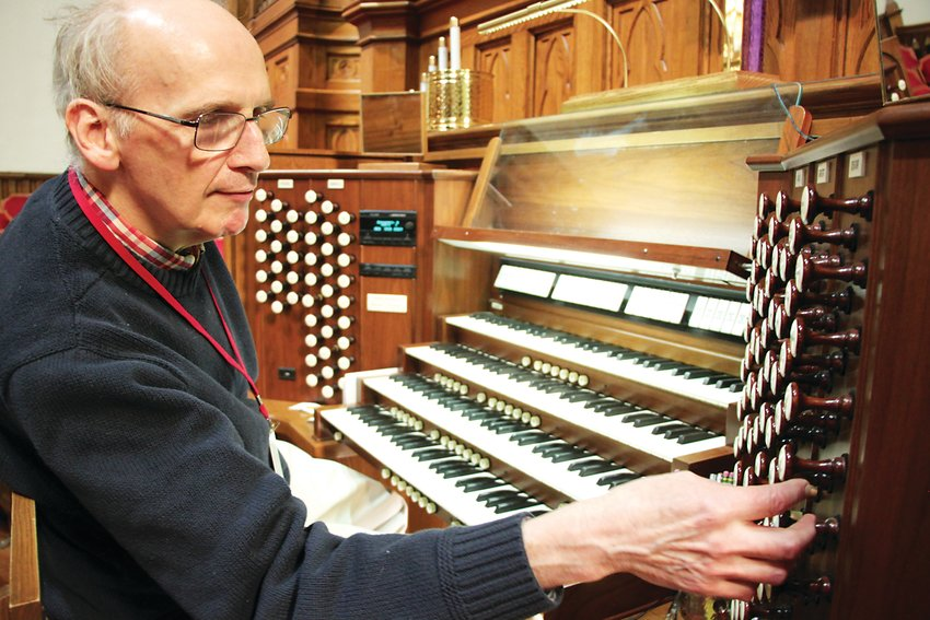 Norm Sutphin, the organist at Denver's Trinity United Methodist Church, said he respects the power and beauty of the instrument.