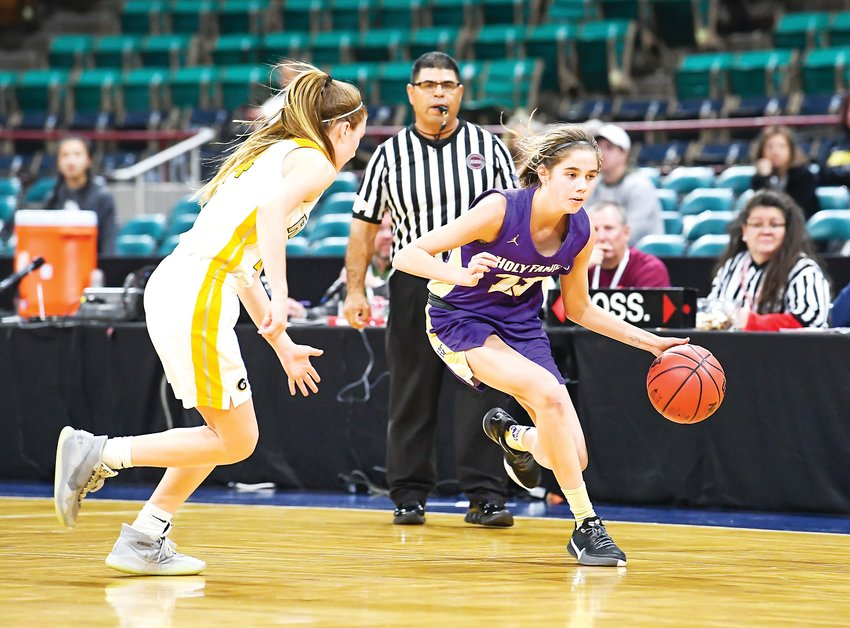 Holy Family's Alyssa Wells (23) works the sideline to avoid pressure from Green Mountain defender Shea Murphy (14). The Tigers hung on to win 38-31 in the 4A Final Four matchup, Thursday Night at the Denver Coliseum.