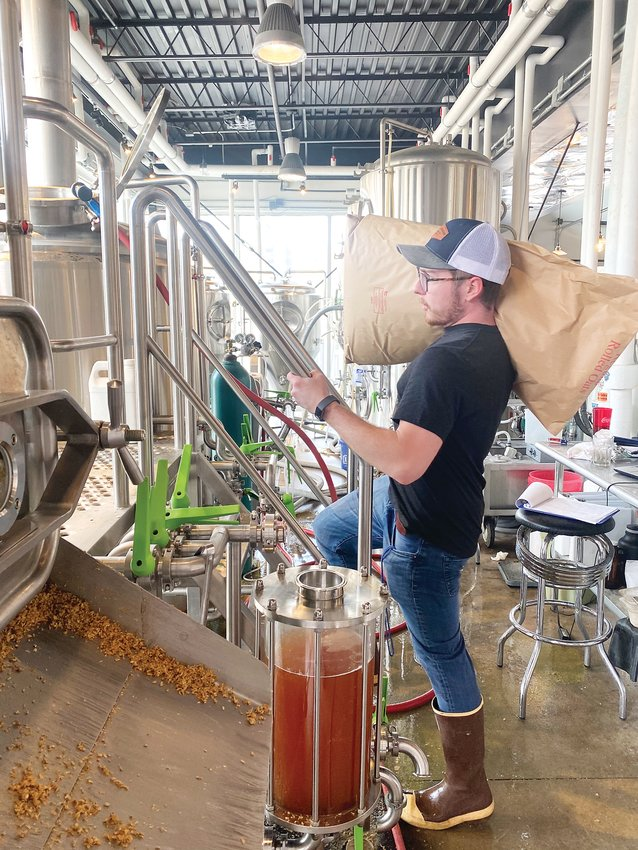 Wild Blue Yonder Brewing Co. Assistant Brewer Garet Clever gets ready to brew the Castle Rock brewpub's next batch of Colorado Cool-Aid IPA on March 17.