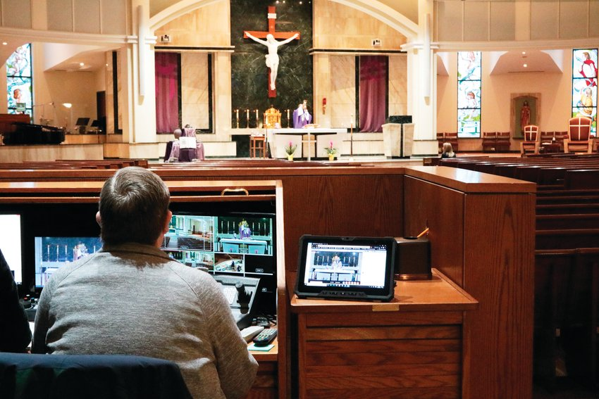 The audiovisual team at St. Thomas More Catholic Church worked to maintain a livestream of the church's daily mass, Friday March 20.