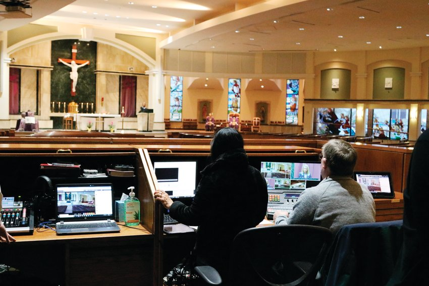 The audiovisual team worked to train other members of the church staff March 20 so that they can alternate who produces the daily mass in the future.