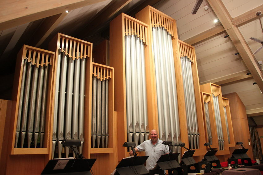 Michael Zehnder stands in front of the 1950s-era Neo-Baroque pipe organ at Ascension Lutheran Church in Littleton.