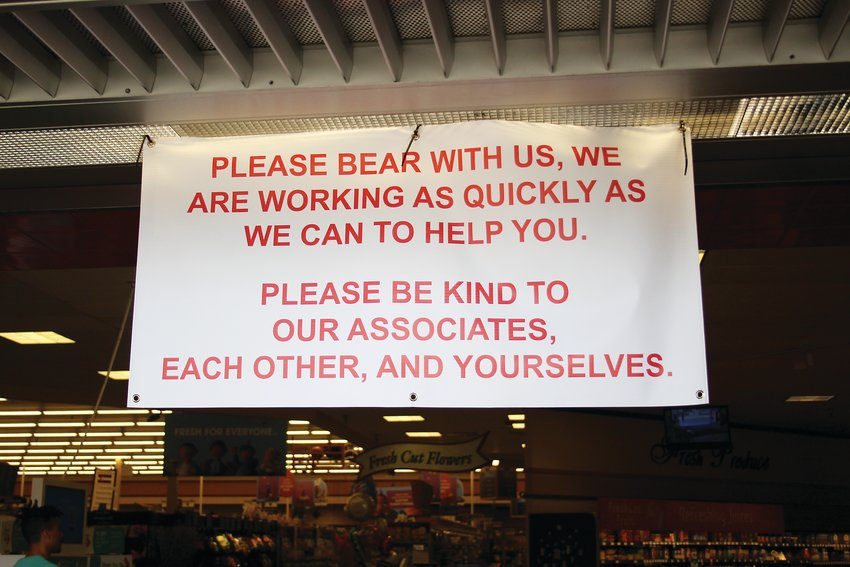 A sign that hangs outside the front of the King Soopers at 6350 Sheridan Blvd. Grocery stores have seen an increase in customers since the COVID-19 pandemic began. Many grocery stores have changed their hours to clean and restock shelves.