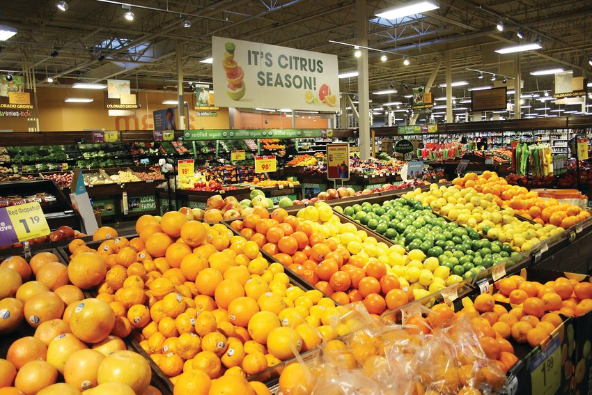 Fresh produce at the King Soopers at 7984 W. Alameda Ave. Richard Schemmel, the store's produce manager, said some of his employees are offering to stay late and work long hours to help keep the grocery store up and running.