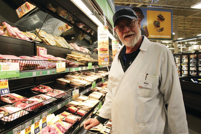 Alex Johnson, a meat clerk at a King Soopers at 7984 W. Alameda Ave. in Lakewood takes a break from working. Johnson said he isn't worried about grocery stores running out of food. Instead, he is more worried about those who have lost their jobs due to the COVID-19 pandemic.