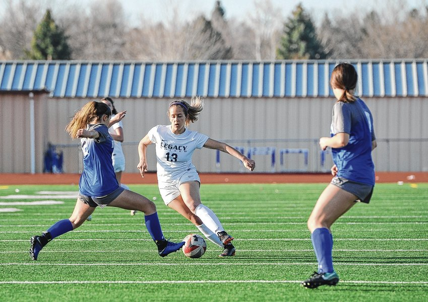Legacy's Ryan Avram (13) tries to maneuver around Broomfield's Brooke Pennington during first-half action April 23, 2019 at Broomfield High School.