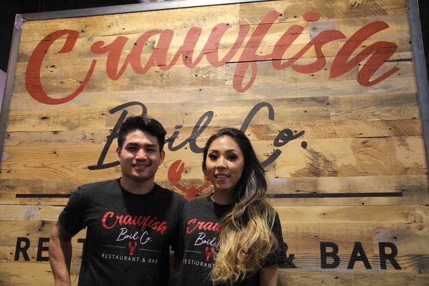Owner Khiem Nguyen, 27, left, and manager Angel Byun, 30, stand March 18 at Crawfish Boil Co. restaurant and bar in The Streets at SouthGlenn outdoor mall.