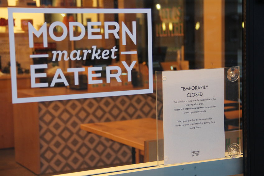 "Modern Market Eatery displays a ""temporarily closed"" sign at The Streets at SouthGlenn."