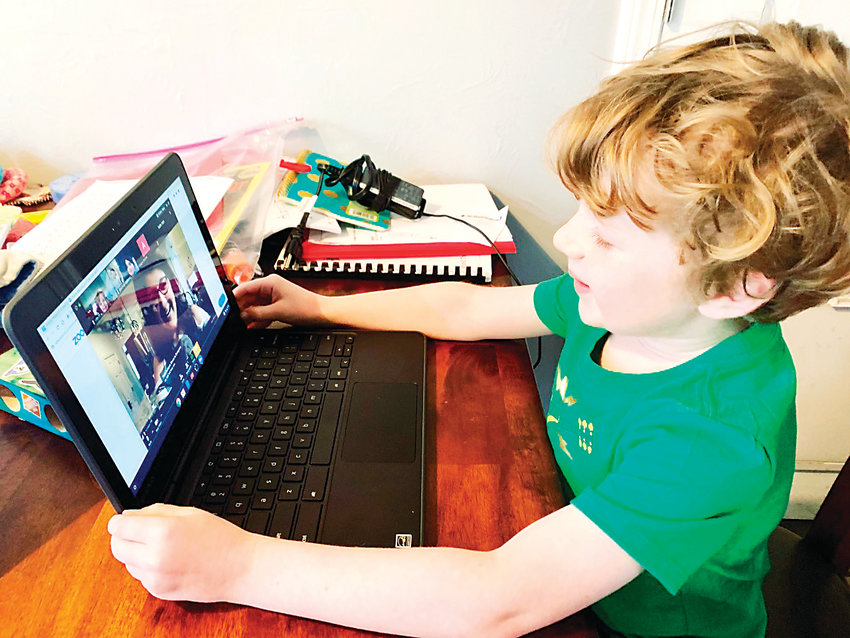 Vanderhoof Elementary first-grader Ville Hulme video chats with his teacher during the first week of Jeffco's remote learning plan..