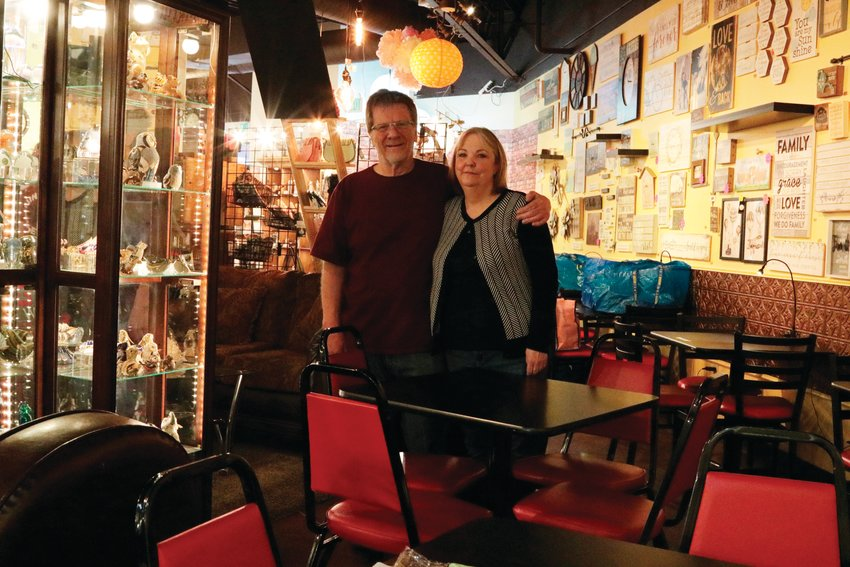Tony and Dawn Whitham stand inside their store, Festive Cup Coffee, a few days after they were required to shut down all dine-in service there. While a few customers trickled in throughout the day to pick up items, the store was mostly empty.